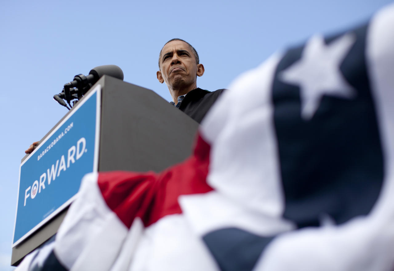 President Barack Obama pauses as he speaks during a campaign event at Bayliss Park, Monday, Aug. 13, 2012, in Council Bluffs, Iowa, during a three day campaign bus tour through Iowa. (AP Photo/Carolyn Kaster)