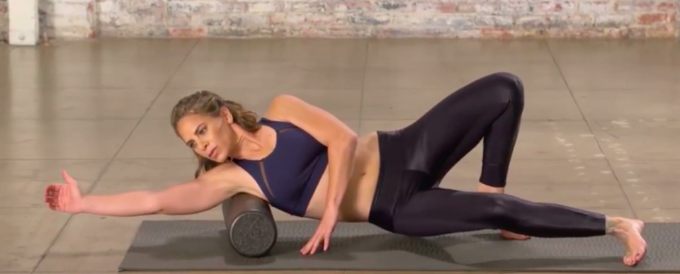 Lend your arms a hand—the foam roller will ease aching biceps. (Photo: Courtesy of Jillian Michaels)