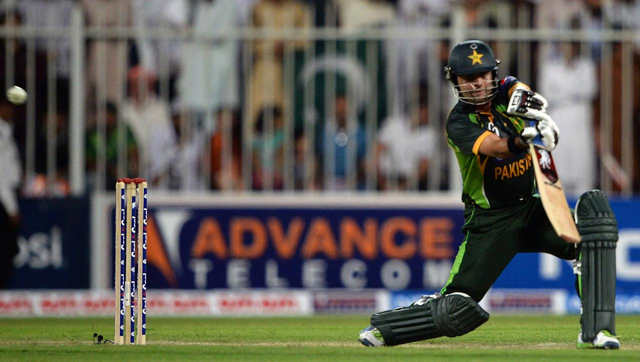 Pakistan's cricketer Ahmad Shehzad plays shot during the first one-day in Sharjah Cricket Stadium in Sharjah on October 30, 2013. South African captain AB de Villiers won the toss and decided to bat in the first of five one-day internationals against Pakistan in Sharjah. AFP PHOTO/ASIF HASSAN        (Photo credit should read ASIF HASSAN/AFP/Getty Images)