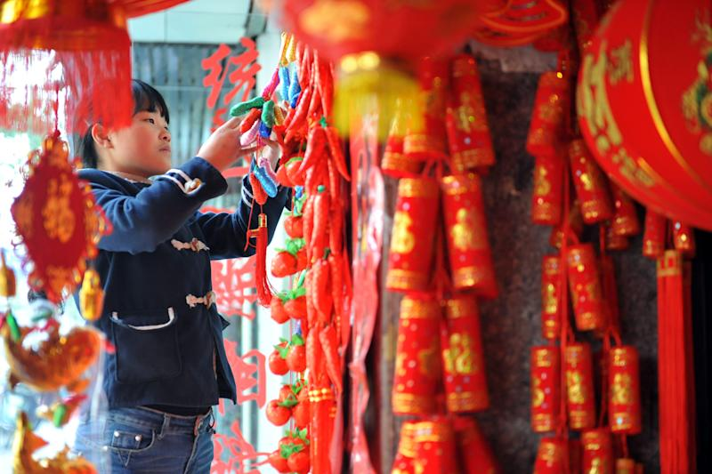 """With the Chinese lunar new year coming up, the loose concept of """"yang"""" might come naturally to Chinese people, but the term can often be a source of frustration for those seeking an equivalent in their own language (AFP Photo/STR)"""
