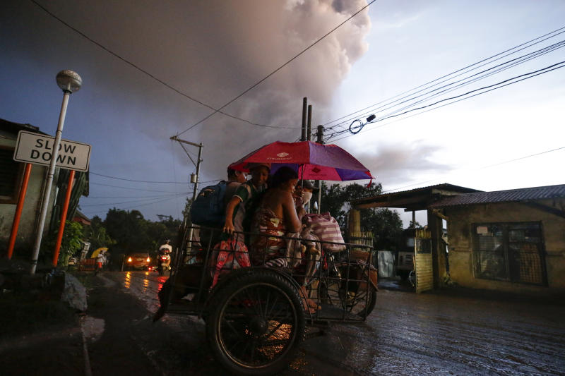 Residents evacuate as Taal Volcano erupts Sunday Jan. 12, 2020, in Tagaytay, Cavite province, outside Manila, Philippines.  (AP Photo/Aaron Favila)