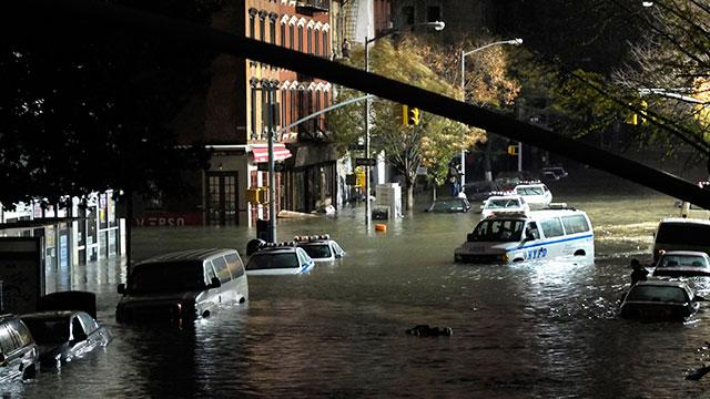 A general view of submerged cars on Ave. C and 7th st, after severe flooding caused by Hurricane Sandy, on October 30, 2012 in Manhattan, New York.