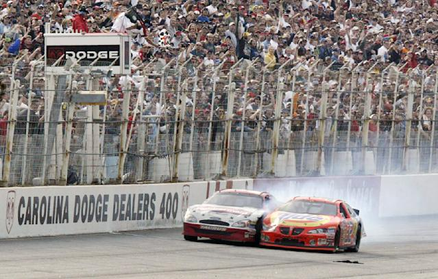 FILE - In this March 16, 2003, file photo, Ricky Craven, right, crosses the finish two-thousandths of a second ahead of Kurt Busch to win the NASCAR Carolina Dodge Dealers 400 at Darlington Raceway in Darlington, S.C. The 70-year-old raceway will host the return of NASCAR Cup Series racing, among the biggest events so far as sports makes a halting comeback from a global shutdown forced by the coronavirus pandemic. (Alison Sidlo/The Morning News via AP, File)