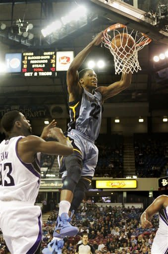 Memphis Grizzlies forward Rudy Gay, right, goes to the basket over Sacramento Kings guard Tyreke Evans during the second half of an NBA basketball game in Sacramento, Calif., Tuesday, March 20, 2012. The Kings won 119-110.(AP Photo/Rich Pedroncelli)