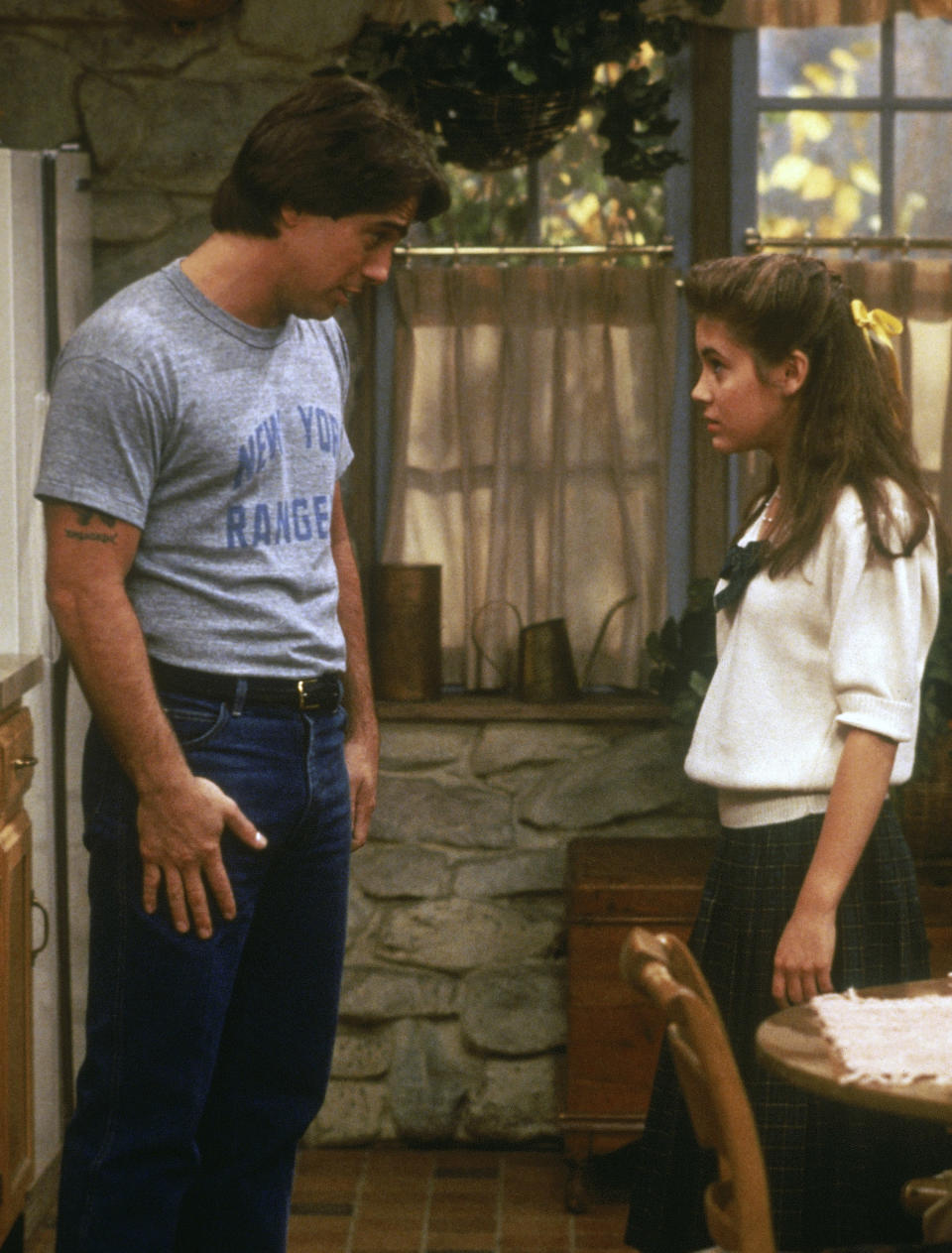 """This image provided by Sony Pictures Television shows Tony Danza, left, as Tony Micelli and Alyssa Milano as Samantha Micelli in a scene from """"Who's The Boss."""" A sequel to the 1980s-'90s sitcom is in the works at Sony Pictures Television, with Danza and Milano set to reprise their father-daughter roles. (Sony Pictures Television via AP)"""