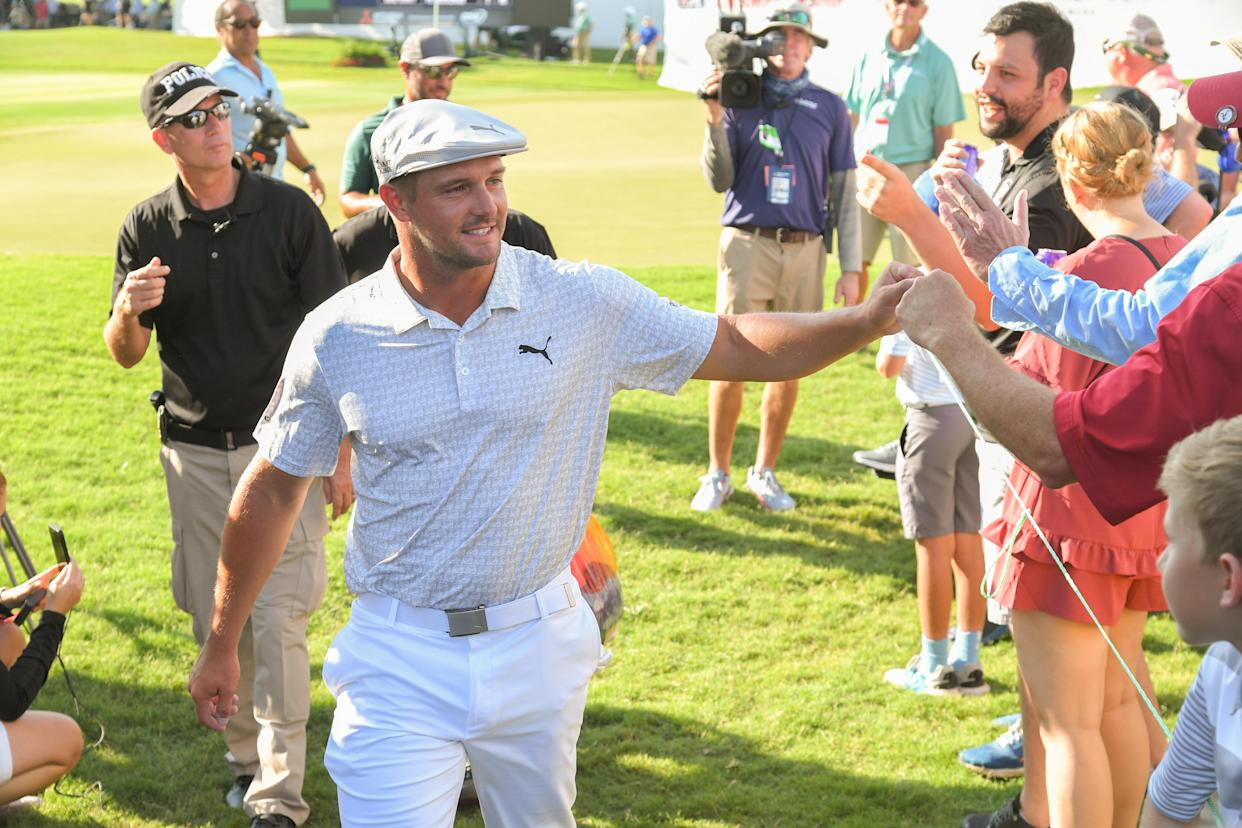ATLANTA, GA - SEPTEMBER 02: Bryson DeChambeau fist bumps fans while walking off the 18th hole during the first round of the TOUR Championship at Eastlake Golf Club on September 2, 2021 in Atlanta, Georgia. (Photo by Ben Jared/PGA TOUR via Getty Images)