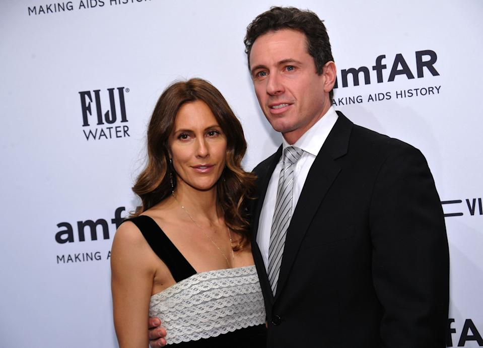 Cristina Cuomo, pictured with husband Chris Cuomo, says she's feeling better after testing positive for the coronavirus. (Photo: Getty Images)