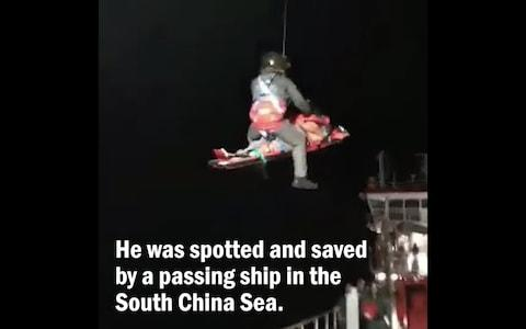 Mr Low was winched to safety from a ship in the South China Sea
