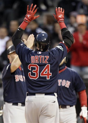 Boston Red Sox's David Ortiz celebrates after hitting a two-run home run against the Chicago White Sox during the second inning of a baseball game in Chicago, Friday, April 27, 2012. (AP Photo/Nam Y. Huh)