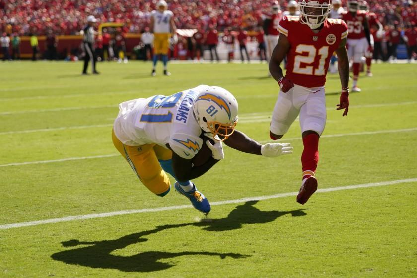 Los Angeles Chargers' Mike Williams (81) makes a touchdown reception against Kansas City Chiefs' Mike Hughes (21) during the second half of an NFL football game, Sunday, Sept. 26, 2021, in Kansas City, Mo. (AP Photo/Charlie Riedel)