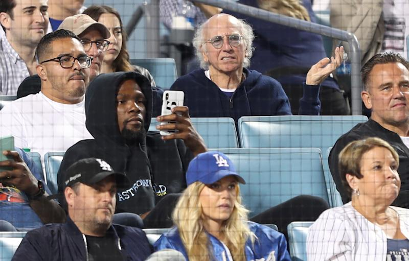Kevin Durant, still nursing an Achilles injury, took in a Dodgers game this summer. (Getty Images)