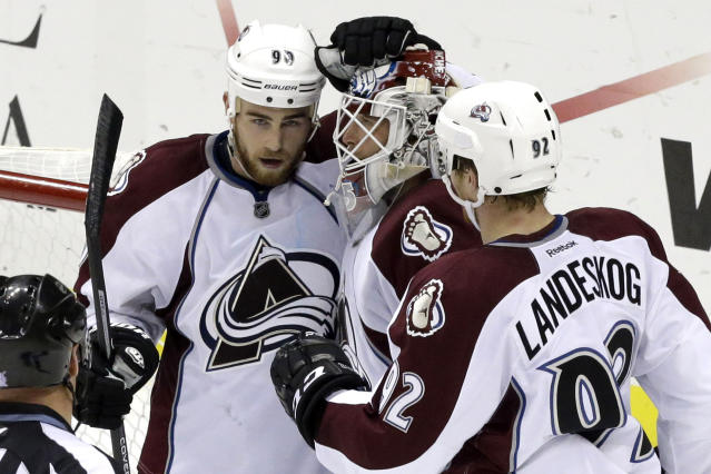 Colorado Avalanche goalie Jean-Sebastien Giguere, center, celebrates with teammates Ryan O'Reilly (90) and Gabriel Landeskog (92), who scored the game's only goal in a 1-0 shutout win over the Pittsburgh Penguins in an NHL hockey game in Pittsburgh Monday, Oct. 21, 2013. (AP Photo/Gene J. Puskar)