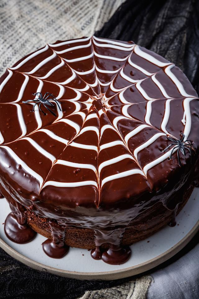 """<p>Nothing is going to come between us and chocolate cake. Not even spiders.</p><p>Get the recipe from <a rel=""""nofollow"""" href=""""http://www.delish.com/holiday-recipes/halloween/recipes/a49352/spiderweb-cake-recipe/"""">Delish</a>.</p>"""