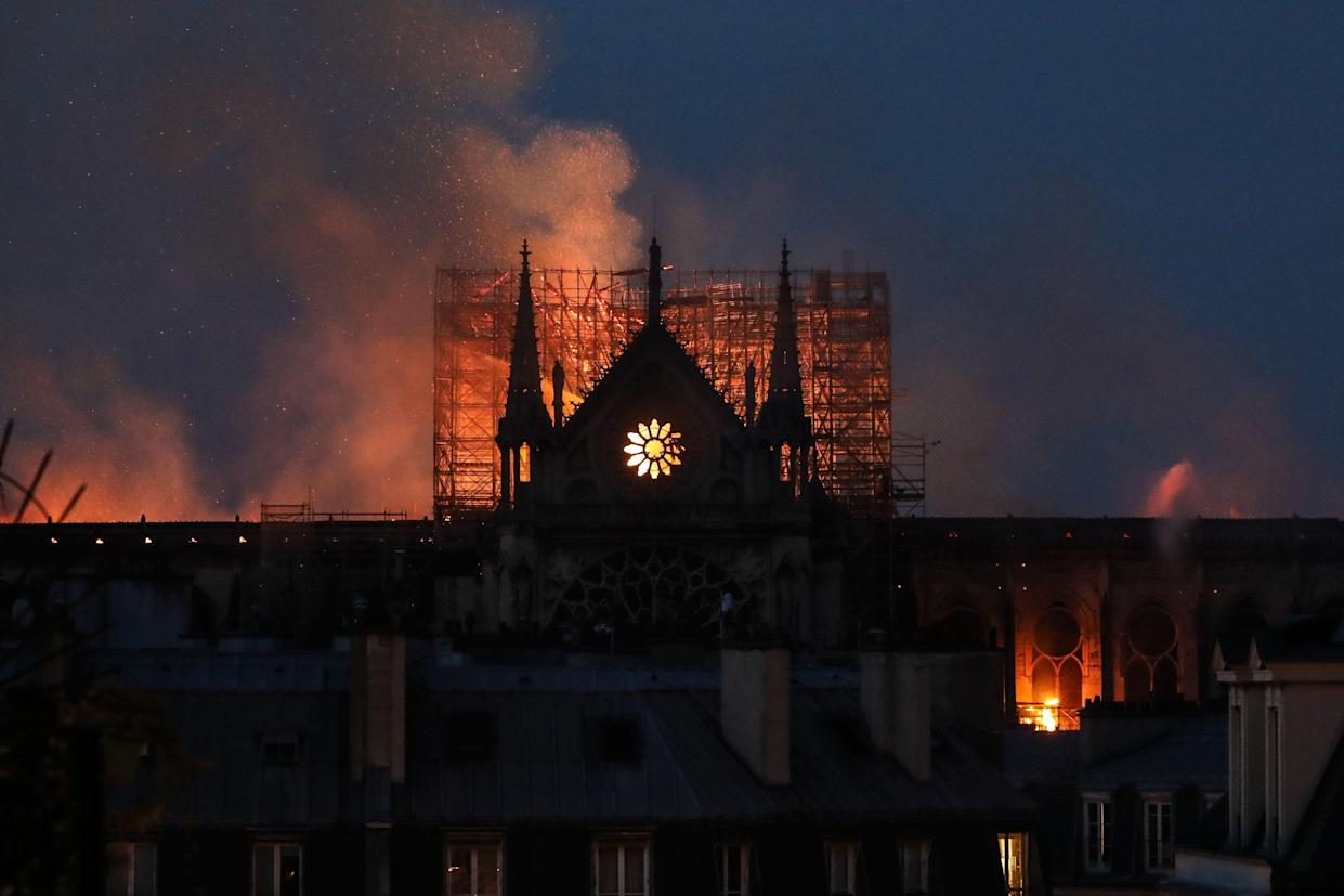 Firefighters douse flames rising from the roof at Notre-Dame Cathedral in Paris on April 15, 2019. (Photo: Ludovic Marin/AFP/Getty Images)