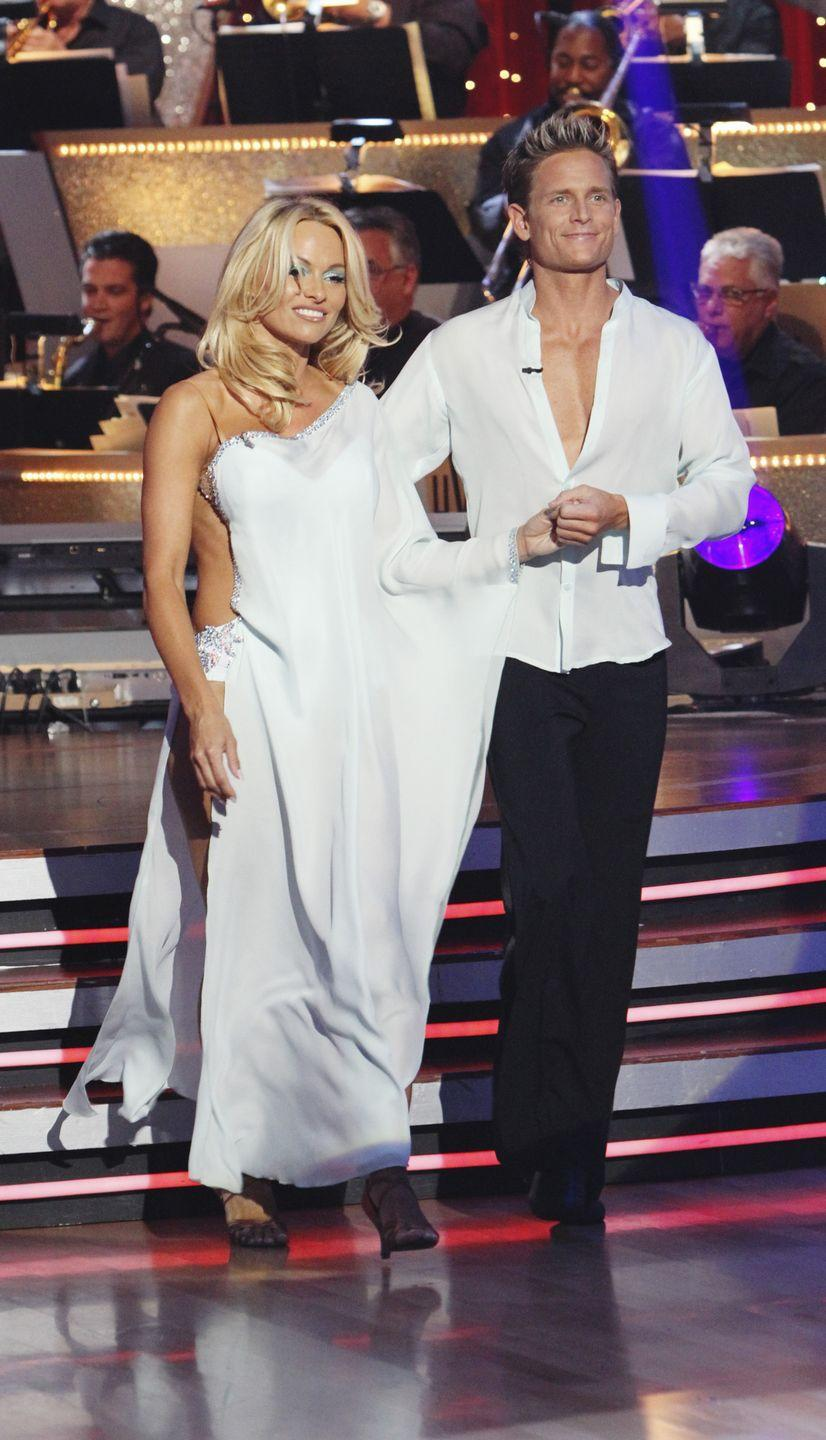 "<p>The <em>Baywatch</em> star competed on seasons 10 and 12 of <em>DWTS</em>, before hopping the pond to appear in the <em>DWTS France</em> ballroom. While practicing, she encountered a petite problem.</p><p>Pamela shared on<a href=""https://www.instagram.com/p/BpCACUbFgW9/"" rel=""nofollow noopener"" target=""_blank"" data-ylk=""slk:Instagram"" class=""link rapid-noclick-resp""> Instagram</a>: ""I hurt my right calf muscle in rehearsal last night. We weren't doing anything crazy just dancing. It felt like someone threw a baseball very hard at my lower leg- I screamed and turned around and no one was there. then realized it was my calf muscle that may have exploded?"" </p>"