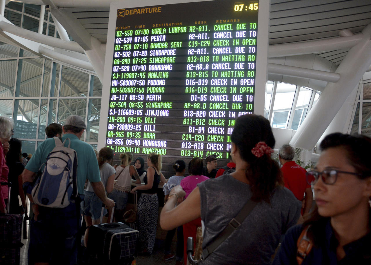<p>A flight information board shows cancelled flights at Ngurah Rai International Airport. Tens of thousands of travelers have been left stranded as ash clouds forced the closure of the tourist island's international airport. (AP Photo/Ketut Nataan) </p>