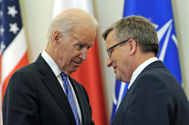 U.S. Vice President Joe Biden, left, and Polish President Bronislaw Komorowski look at each others after a press conference following their talks in Warsaw, Poland, Tuesday, March 18, 2014. Biden arrived in Warsaw for consultations with Prime Minister Donald Tusk and President Bronislaw Komorowski, a few hours after Russian President Vladimir Putin approved a draft bill for the annexation of Crimea, one of a flurry of steps to formally take over the Black Sea peninsula. (AP Photo/Alik Keplicz)
