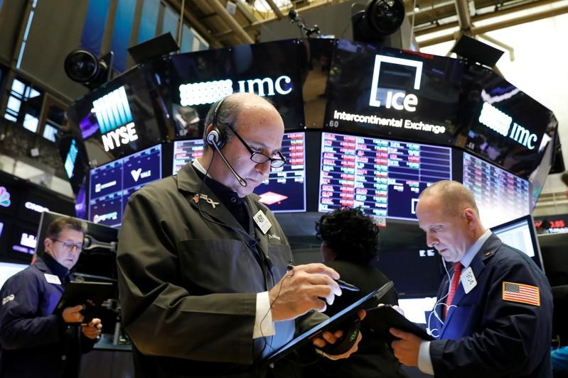 Wall Street crawls to record levels on trade hopes