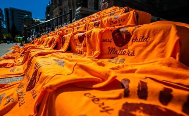 Shoes, teddy bears and orange shirts laid on the front steps of the B.C. Legislature on June 9. Events and ceremonies will be taking place on the inaugural National Day for Truth and Reconciliation on Sept. 30, also known as Orange Shirt Day. (Mike McArthur/CBC - image credit)