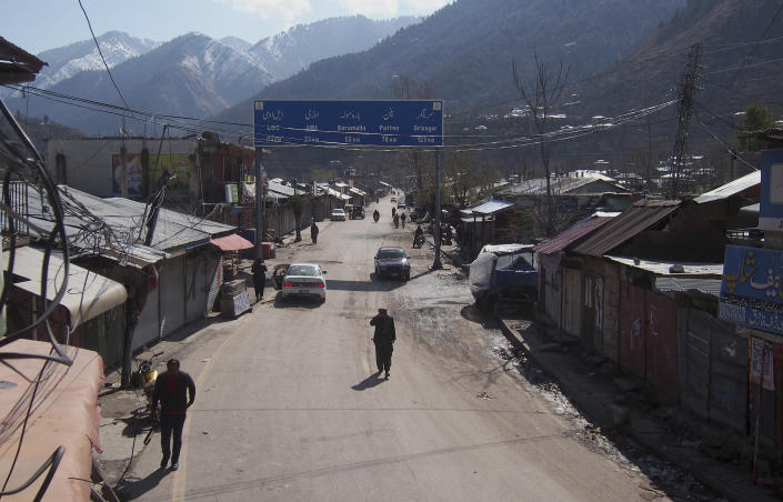 Pakistani Kashmiris walk through the closed main market, following the intense exchange of fire between Pakistan and India at the border town of Chakoti at the Line of Control in Pakistani Kashmir, Wednesday, Feb. 27, 2019. Pakistan's air force shot down two Indian warplanes after they crossed the boundary between the two nuclear-armed rivals in the disputed territory of Kashmir on Wednesday and captured one Indian pilot, a military spokesman said. (AP Photo/M.D. Mughal)