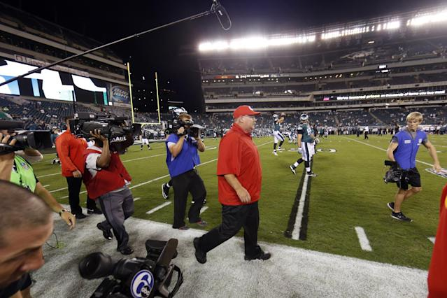 Former Philadelphia Eagles coach Andy Reid, now the Kansas City Chiefs coach, walks the sidelines before the Chiefs' NFL football game against the Philadelphia Eagles, Thursday, Sept. 19, 2013, in Philadelphia. (AP Photo/Matt Rourke)