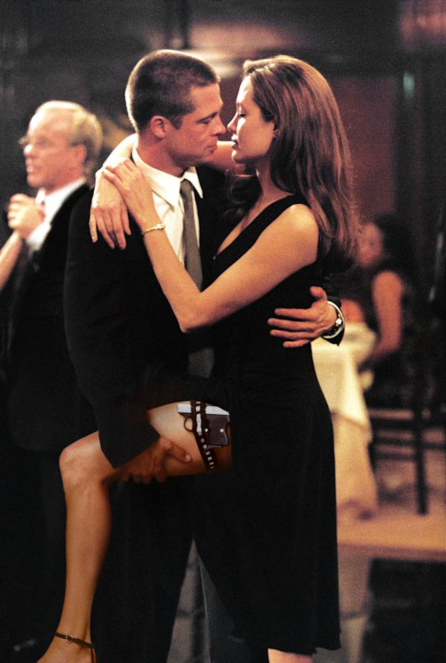 """<a href=""""http://movies.yahoo.com/movie/contributor/1800018965"""">BRAD PITT</a> & <a href=""""http://movies.yahoo.com/movie/contributor/1800019275"""">ANGELINA JOLIE</a>  MOVIE: <a href=""""http://movies.yahoo.com/movie/1808623299/info"""">Mr. & Mrs. Smith</a> (2005)   Tabloids went crazy when Brangelina got together on the set, and audiences flocked to see them light up the screen both with heavy fire power and their undeniable chemistry. There was reportedly an even racier love scene shot for the movie, but it was cut in the interest of keeping the flick PG-13."""