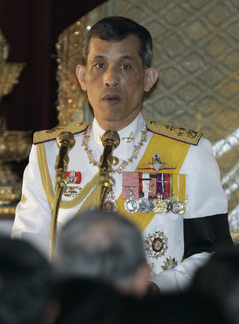 """FILE - In this Jan 21, 2008 file picture Thai Crown Prince Vajiralongkorn reads a statement as he presides over the opening ceremony of the house of representatives at the Ananthasamakhom throne in Bangkok, Thailand.    Officials say the  plane being used by Thailand's Crown Prince Vajiralongkorn has been impounded in Munich, Germany as part of a long-running battle over payments for a building project in Thailand, and Munich airport spokesman Robert Wilhelm said Wednesday July 13, 2011, that the Boeing 737 """"Royal Flight"""" was seized on a court order, and is now immobilized and sealed at the airport.  (AP Photo/Sakchai Lalit, File)"""