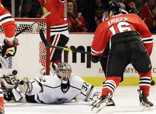Los Angeles Kings goalie Jonathan Quick (32) can't save a shot by Chicago Blackhawks' Marcus Kruger (16) during the second period of an NHL hockey game in Chicago, Sunday, March 11, 2012. (AP Photo/Nam Y. Huh)