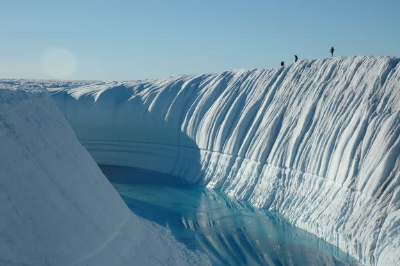 An ice canyon with ice melt flowing through.