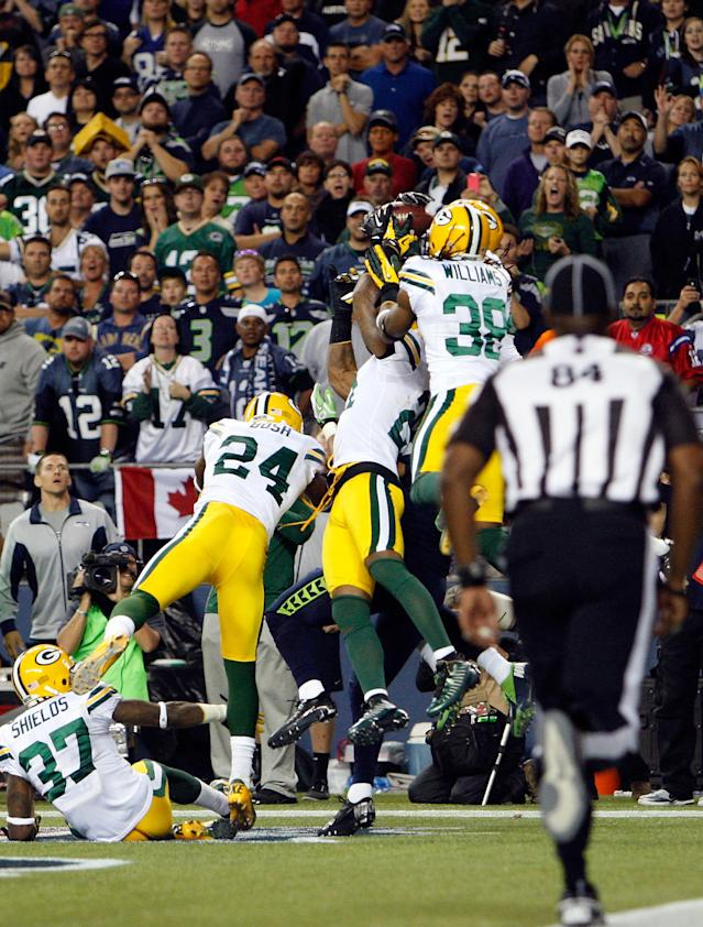 SEATTLE, WA - SEPTEMBER 24: Golden Tate #81 of the Seattle Seahawks makes the game winning catch as time expired behind a swarm of Green Bay Packers at CenturyLink Field on September 24, 2012 in Seattle, Washington. The Seahawks defeated the Packers 14-12. (Photo by Kevin Casey/Getty Images)