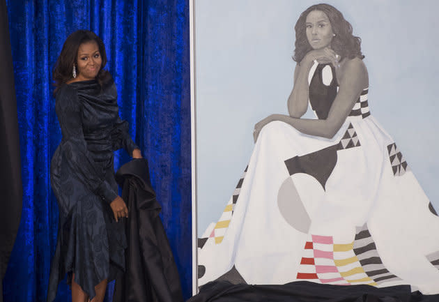 Michelle Obama unveils her official portrait at the Smithsonian's National Portrait Gallery in Washington. It has drawn such big crowds that the gallery has moved it to a more spacious location.