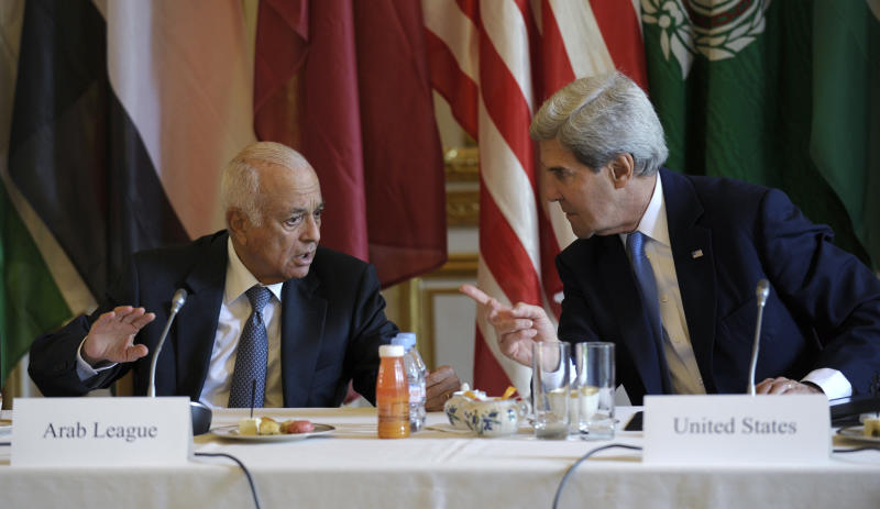 US Secretary of State. John Kerry. talks with Arab League Secretary General Nabil Elaraby before the start of a meeting with representatives of the Arab League at the United States Embassy in Paris, Sunday, Sept. 8, 2013. (AP Photo/Susan Walsh, Pool)