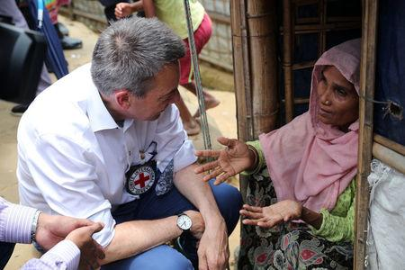 Peter Maurer, president of the International Committee of the Red Cross (ICRC), interacts with a Rohingya woman during his visit to a refugee camp in Cox's Bazar, Bangladesh, July 1, 2018. REUTERS/Mohammad Ponir Hossain