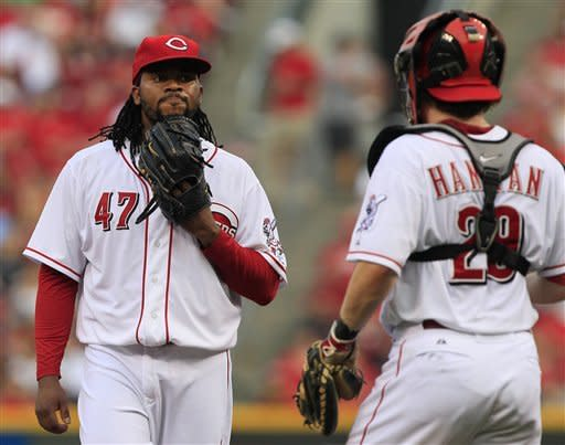 Cincinnati Reds starting pitcher Johnny Cueto (47) talks with catcher Ryan Hanigan during the third inning of a baseball game against the Colorado Rockies, Friday, May 25, 2012, in Cincinnati. Cueto was the losing pitcher as Colorado won 6-3. (AP Photo/Al Behrman)