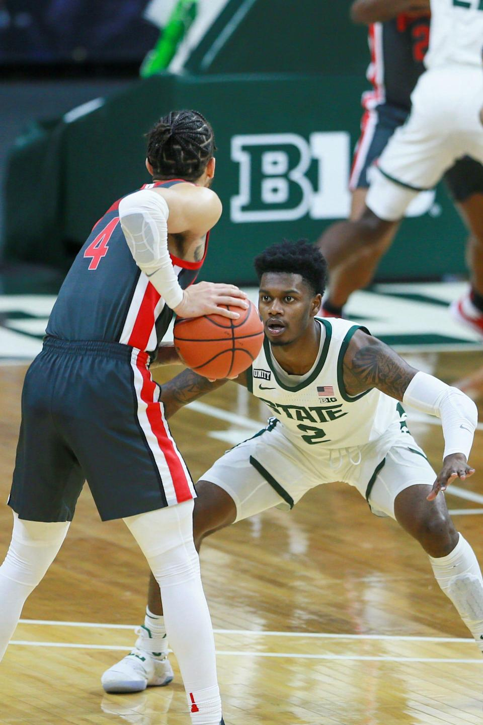 Michigan State guard Rocket Watts guards Ohio State guard Duane Washington Jr. in the first half against Ohio State on Thursday, Feb. 25, 2021, in East Lansing.