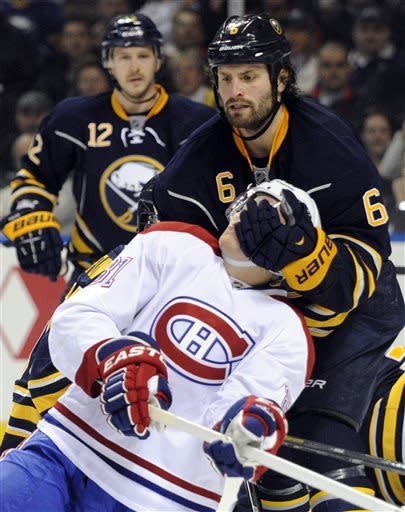 Buffalo Sabres defenseman Mike Weber (6) puts a glove to the face of Montreal Canadiens' Lars Eller (81), of Denmark, during the second period of an NHL hockey game in Buffalo, N.Y., Thursday, April 11, 2013. (AP Photo/Gary Wiepert)