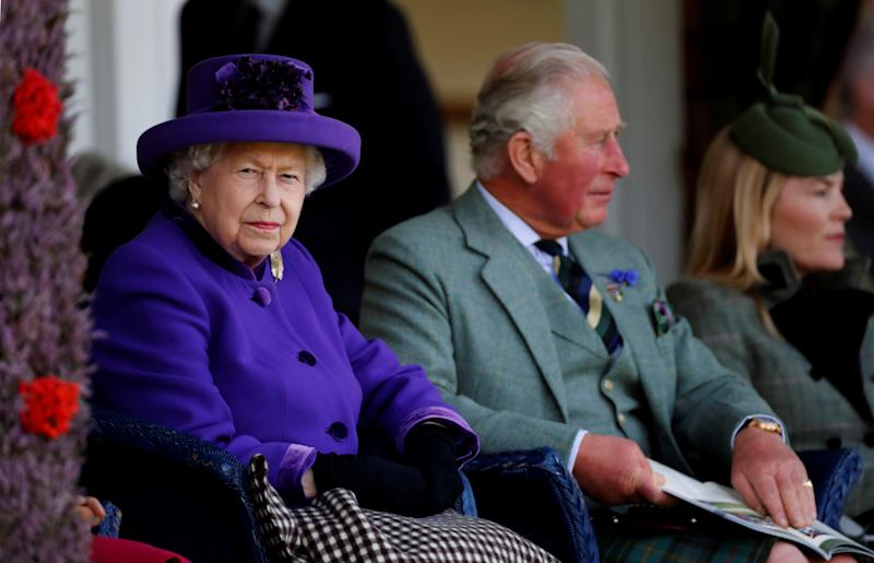 Britain's Queen Elizabeth and Prince Charles watch the proceedings at the annual Braemar Highland Gathering in Braemar, Scotland, Britain, September 7, 2019. REUTERS/Russell Cheyne
