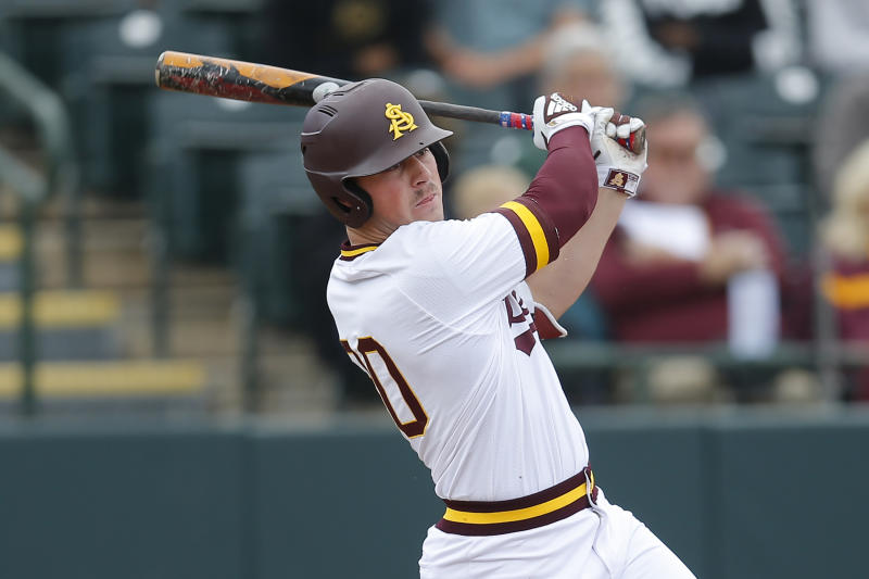 FILE - In this Feb. 17, 2019, file photo, Arizona State's Spencer Torkelson bats during an NCAA college baseball game against Notre Dame in Phoenix. The Detroit Tigers are rebuilding around an impressive group of minor league pitchers. Now, it might be time to add a star hitting prospect to the mix. Whether it's Arizona State slugger Spencer Torkelson or somebody else, Detroit has a chance to add another potential standout when it makes the No. 1 selection in Wednesday night's Major League Baseball draft. (AP Photo/Rick Scuteri, File)
