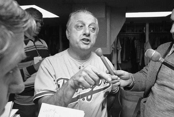 Dodgers Manager Tom Lasorda talks to reporters after his team lost the first game of the World Series, 4-3.