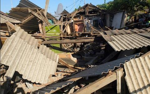 <span>Houses damaged by an earthquake are seen in North Lombok, Indonesia</span> <span>Credit: AP </span>