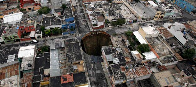 In 2010 a sinkhole covered a street intersection in downtown Guatemala City. Authorities blamed heavy rains caused by tropical storm Agatha as the cause of the crater that swallowed a a three-story building. Credit: AP