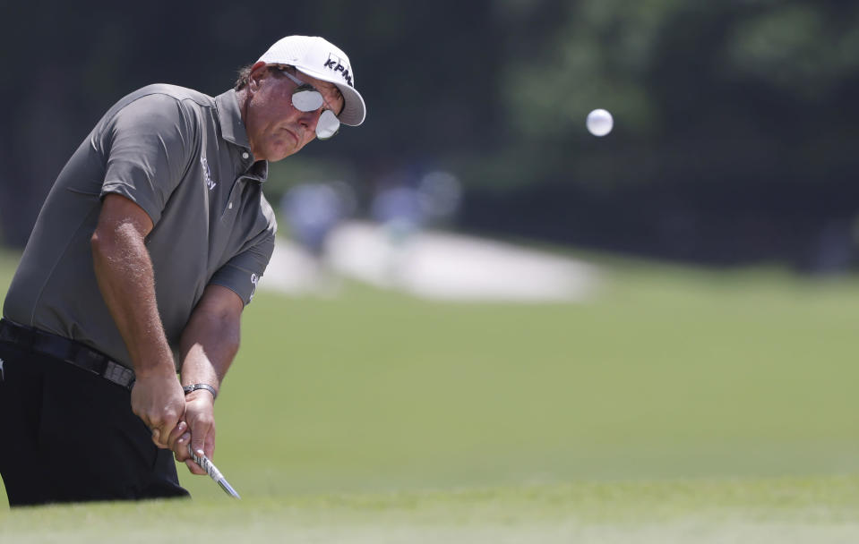 Phil Mickelson plays his shot on the fifth hole during the first round of the Charles Schwab Challenge golf tournament at the Colonial Country Club in Fort Worth, Texas, Thursday, May 27, 2021. (AP Photo/Ron Jenkins)