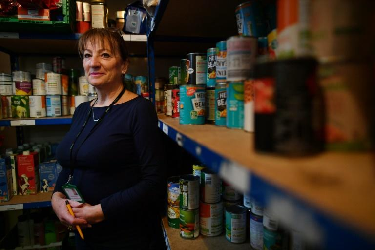 Sue Sibany-King manages the food bank at the Slough Baptist Church in a large industrial town of 162,000 people (AFP Photo/BEN STANSALL)