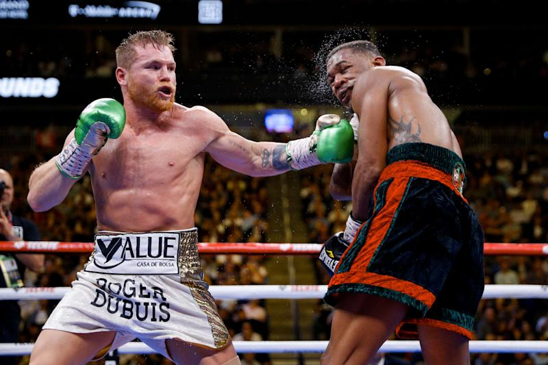 Canelo Alvarez, left, of Mexico, hits Daniel Jacobs during a middleweight title boxing match Saturday, May 4, 2019, in Las Vegas. (AP Photo/John Locher)