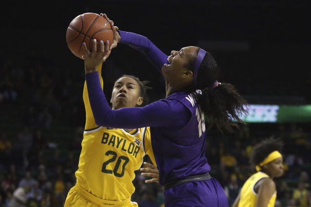 TCU guard Jayde Woods (15) attempts a shot against Baylor guard Juicy Landrum (20) in the first half of an NCAA college basketball game, Wednesday, Feb. 12, 2020, in Waco, Texas. (AP Photo/Jerry Larson)