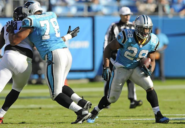 Carolina Panthers' Jonathan Stewart (28) runs against the Atlanta Falcons in the second half of an NFL football game in Charlotte, N.C., Sunday, Nov. 3, 2013. (AP Photo/Mike McCarn)