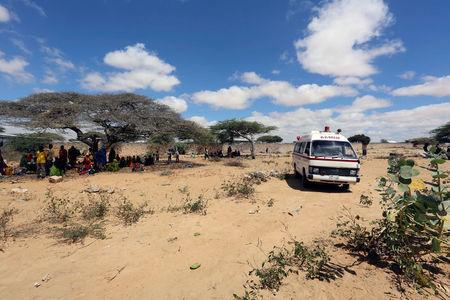 An Aamin Ambulance transports diarrhea patients to the Banadir hospital from a camp for the internally displaced people on the outskirts Mogadishu