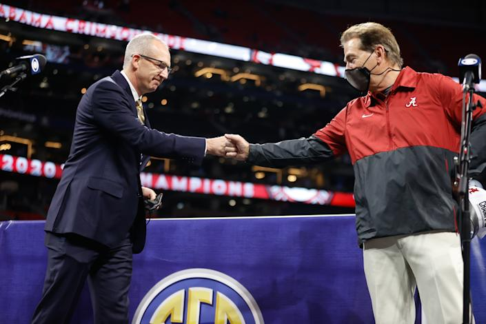 ATLANTA, GA - DECEMBER 19: Head Coach Nick Saban of the Alabama Crimson Tide fist bumps Southeastern Conference Commissioner Greg Sankey after the victory over the Florida Gators in the SEC Championship at Mercedes-Benz Stadium on December 19, 2020 in Atlanta, Georgia. (Photo by UA Athletics/Collegiate Images/Getty Images)