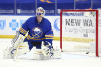 Buffalo Sabres goalie Dustin Tokarski reacts after giving up a goal to Boston Bruins forward Matt Grzelcyk during the second period of an NHL hockey game, Thursday, April 22, 2021, in Buffalo, N.Y. (AP Photo/Jeffrey T. Barnes)