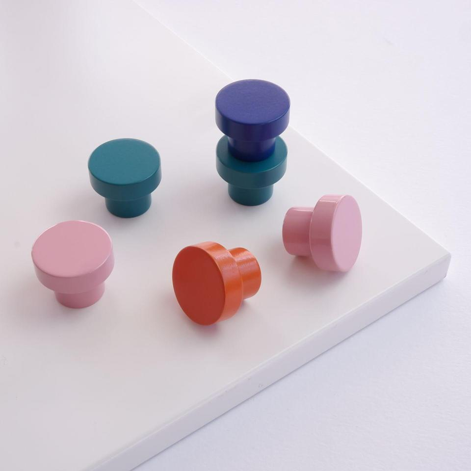 """<p>You don't even need to replace your kitchen cupboards and drawers to add a splash of colour. Simply add some new handles. A quick and easy update, Swarf's 'Hobson' and 'Meteor' knobs are available in 10 colours. From £14, <a href=""""https://swarfhardware.co.uk/"""" rel=""""nofollow noopener"""" target=""""_blank"""" data-ylk=""""slk:swarfhardware.co.uk"""" class=""""link rapid-noclick-resp"""">swarfhardware.co.uk</a><br></p>"""